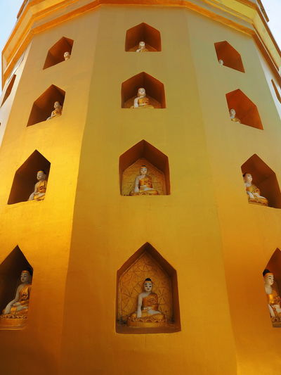 Low angle view of buddha sculpture at mount popa shrine