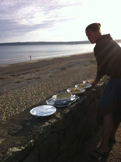 preparing dinner to eat on the beach at Marazion, Cornwall Dinner On Beach Beach Dusk Food Horizon Over Water Outdoors Plates Sand Sea Sky Water