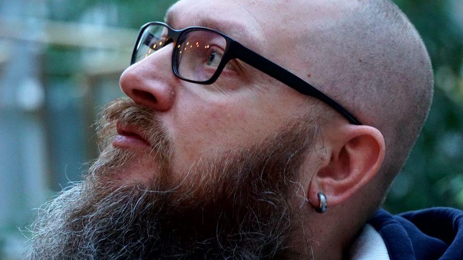 Close-up of bearded man wearing eyeglasses