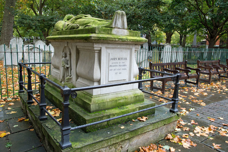 The tomb of John Bunyan, the author of Pilgrims Progress Grave John Bunyan Memorial Pilgrims Progress Tomb Architecture Author Autumn Book Day Leaf Nature No People Outdoors Railing Sculpture Statue Tree