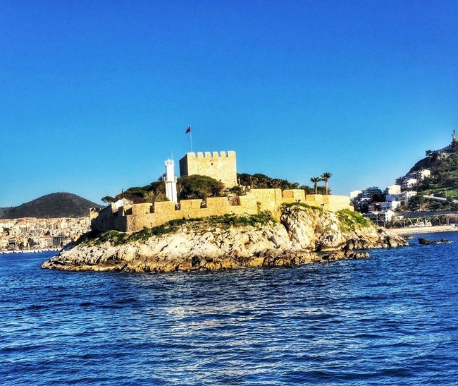 Blue Clear Sky Building Exterior Architecture Sea Waterfront Built Structure Water Outdoors Nature No People Day Rock - Object Beauty In Nature Kusadasi