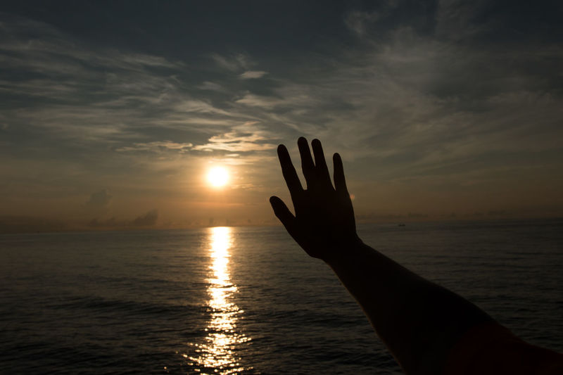 Beauty In Nature Body Part Cloud - Sky Finger Hand Horizon Over Water Human Body Part Human Hand Human Limb Nature One Person Outdoors Real People Scenics - Nature Sea Silhouette Sky Sun Sunlight Sunset Tranquility Unrecognizable Person Water