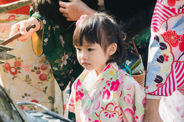 High Angle View Of Girl In Kimono Standing Outdoors