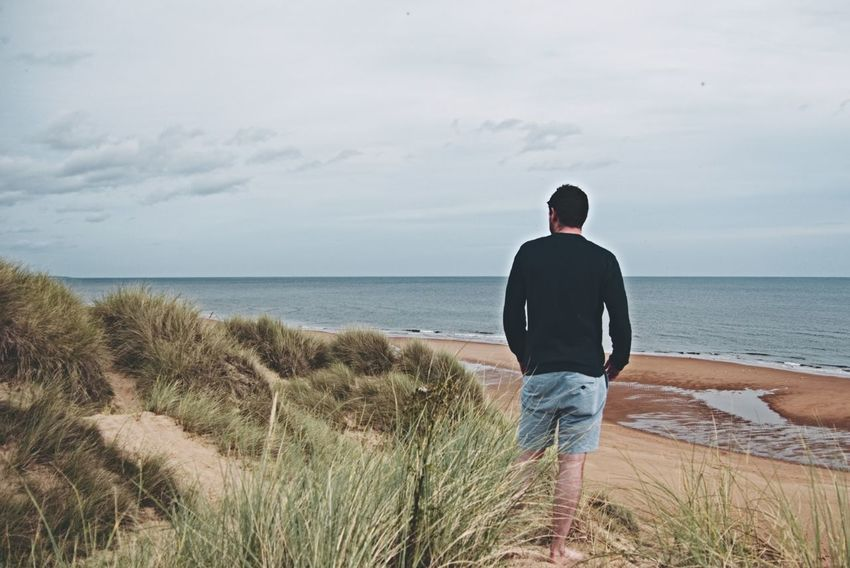 Balmedie Beach Sea Beach One Man Only Horizon Over Water Sand Rear View Vacations Adult One Person Outdoors Full Length People Nature Summer Aberdeenshire Balmedie Scotland Balmedie Beach Water Tranquil Scene Awe Atmospheric Mood Coastal Feature Travel Destinations Standing