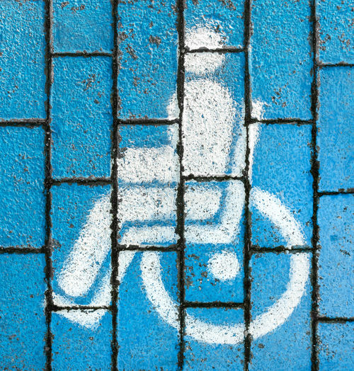 Disabled access sign on footpath in city