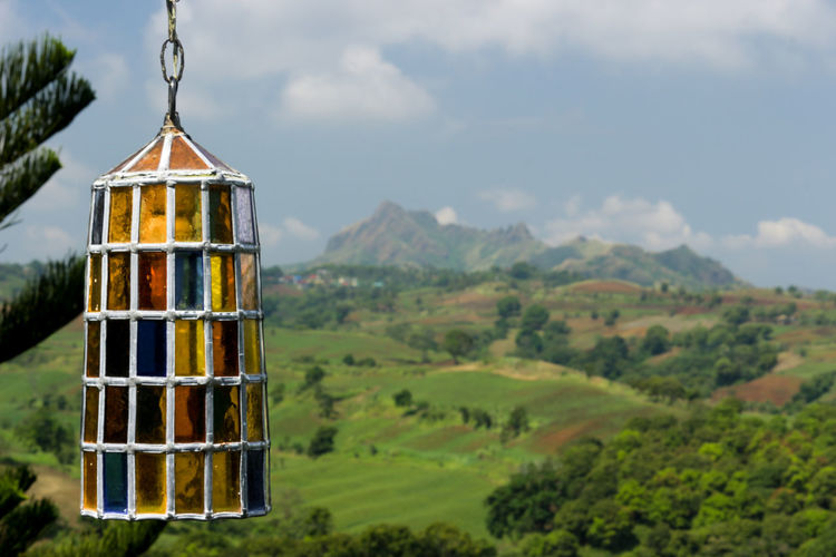 The Lantern Calaruega Tropical Climate DSLR Canonphotography No People Non-urban Scene Outdoors Glass Lantern Scenics Green Landscape Lantern Stained Glass Stained Glass Lantern See What I See Landscape Greenery Nature Natureporn Sky And Clouds Bokeh Hills Green Hills Tropical Plants Tropical Beauty In Nature Countryside Farmland Cultivated Land Plantation Crop