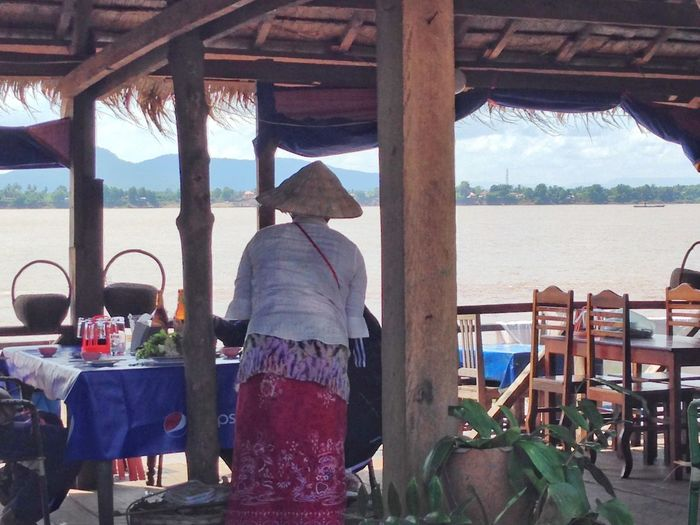 Laos LaoStyle Laos, Lao Trip Southeastasia Eye4photography  Streetphotography Asian Culture Asian Girl Scenic View Landscape_Collection Travel Photography Landscape_photography Beautful Nature Asianwoman Serving People Want To Be Loved Alone Lonely Southeastasia Restaurant Outdoor Cafe Asian Cafe Asian Hat