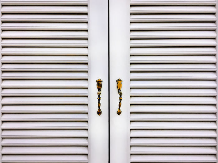 White Wooden Grille Windows with Metallic Handles Architectural Detail Blinds Close-up Day Decoration Grille Metal Metallic Handles No People Outdoors Pattern Retro Styled White Windows