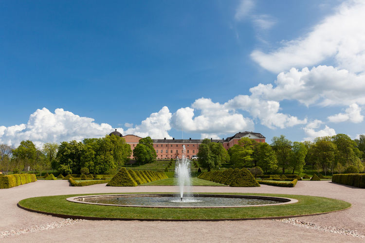 Distant view of the Uppsala Castle from the uppsala botanic garden including fountains. Architecture Botanic Garden Castle Europe Fountain Fountain Garden Outdoors Park - Man Made Space Scandinavia Sky Sweden Tree Uppsala Uppsala Castle Uppsala, Sweden