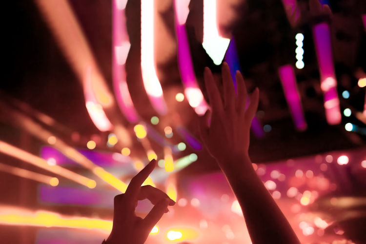 Hand Human Hand Human Body Part Illuminated Night Nightlife Music Enjoyment Arts Culture And Entertainment Light - Natural Phenomenon Tecnology Nightclub Multi Colored Selective Focus Lighting Equipment Body Part Stage Finger Clubbing