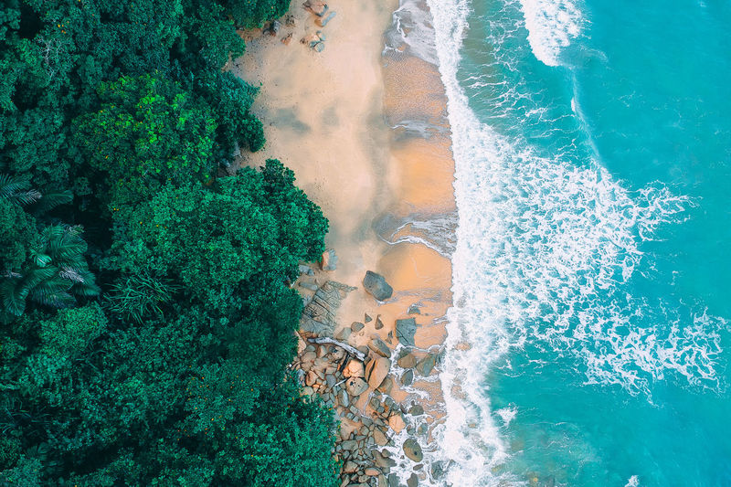 Water Sea Motion Beauty In Nature Nature Sport High Angle View Wave Day Power No People Aquatic Sport Power In Nature Land Outdoors Green Color Beach Splashing Breaking Turquoise Colored Hitting