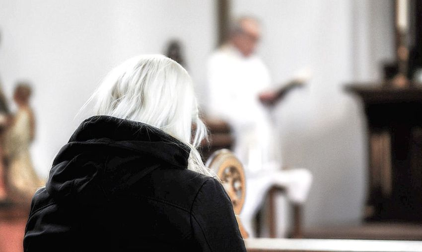 Rear view of woman in church