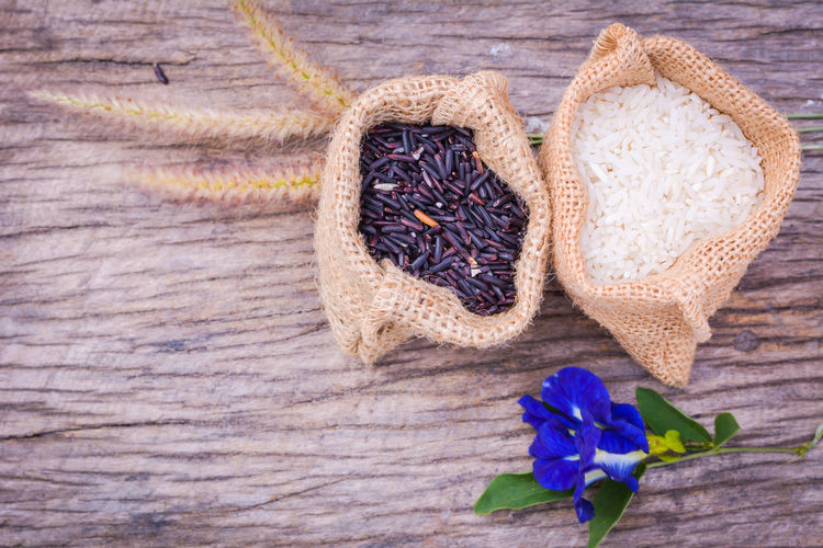 Black rice and Raw grain in burlap bag on wood background,Jasmine rice Food And Drink Freshness Nature Day Flower Food Food Photography Healthy Eating Healthy Food Indoors  Indoors Outdoors Leaf No People Organic Food Rice - Food Staple Spices Food Table Wood - Material