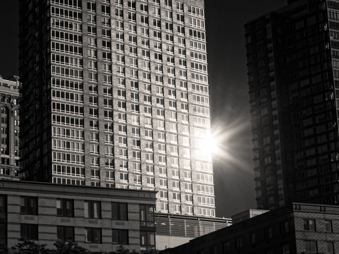 Architecture Built Structure Building Exterior Skyscraper Sunlight City Low Angle View No People Modern Outdoors Sun Day Sky sun spot Zörk