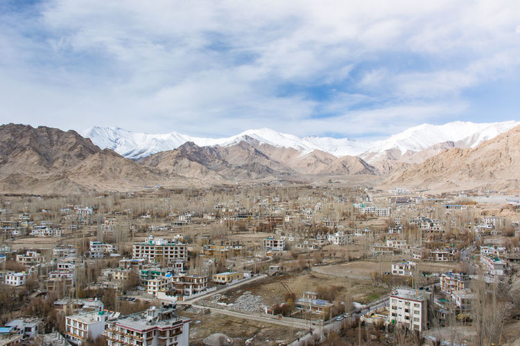 Aerial view of townscape with mountain in background