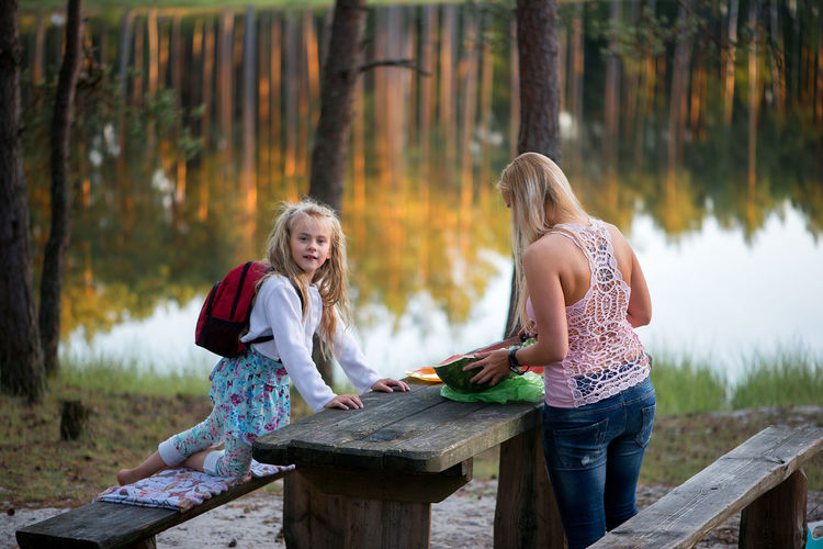 Woman and girl at picnic table