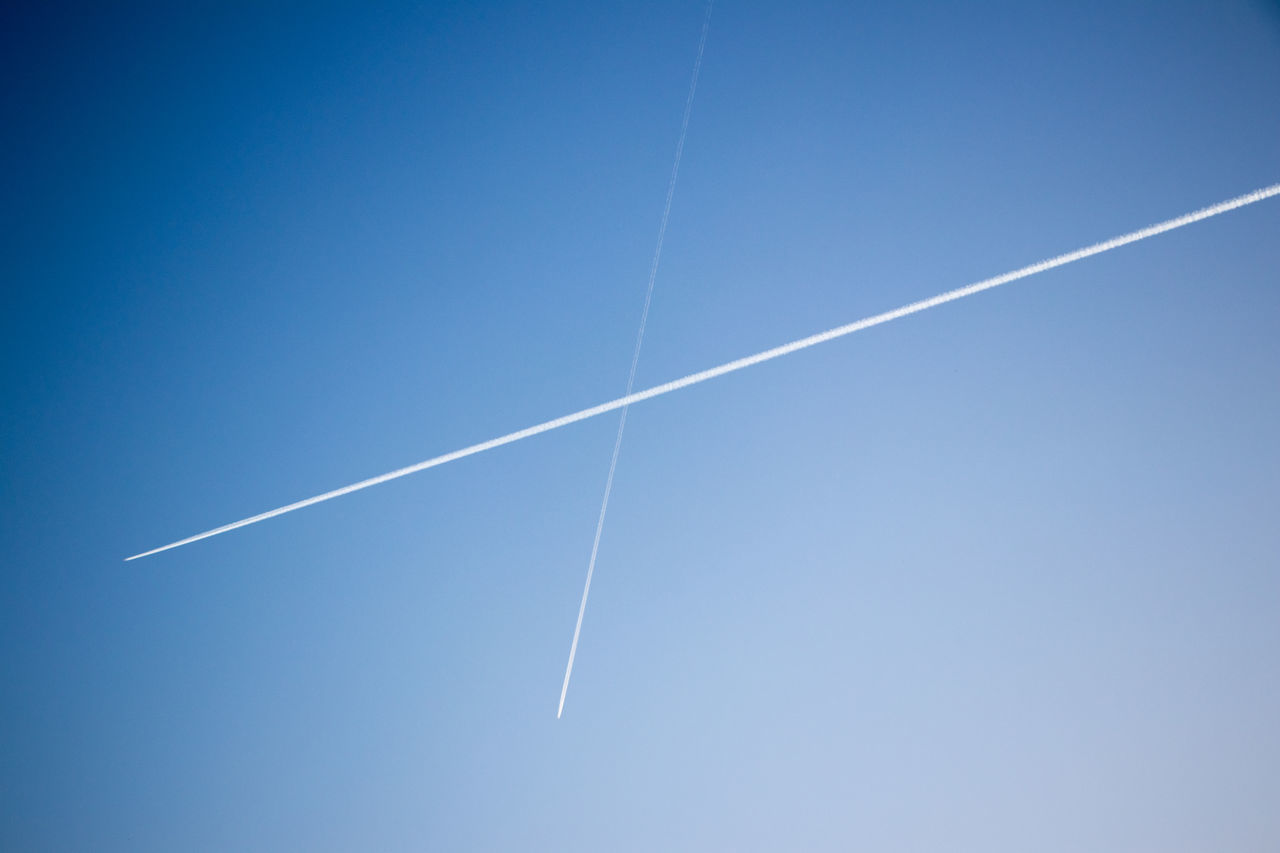 vapor trail, sky, blue, no people, clear sky, low angle view, nature, day, copy space, flying, beauty in nature, air vehicle, outdoors, motion, transportation, white color, speed, backgrounds, scenics - nature