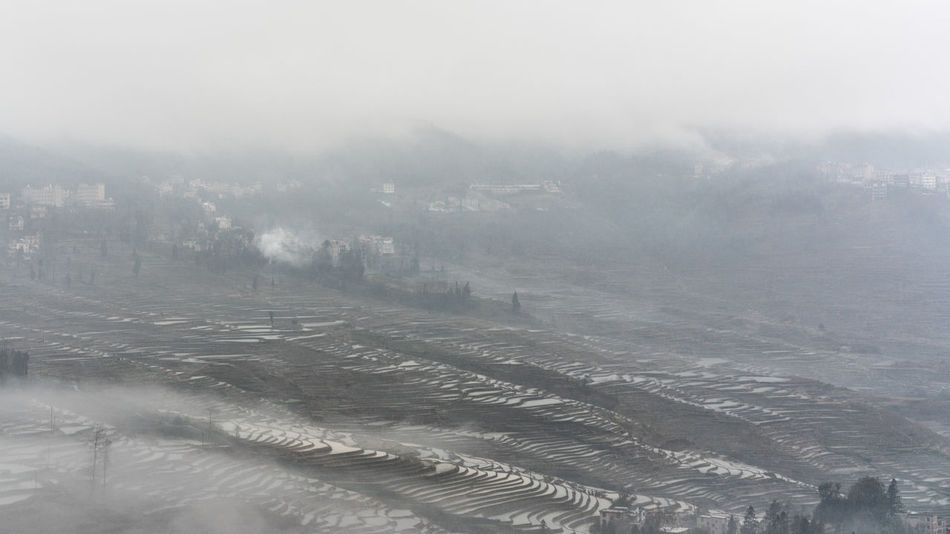 Yuanyang Terraced Fields Aerial View Agriculture Beauty In Nature City Cold Temperature Day Fog High Angle View Landscape Mountain Nature No People Outdoors Rural Scene Scenics Sky Snow Tranquil Scene Tranquility Weather Winter Yuanyang Yunnan