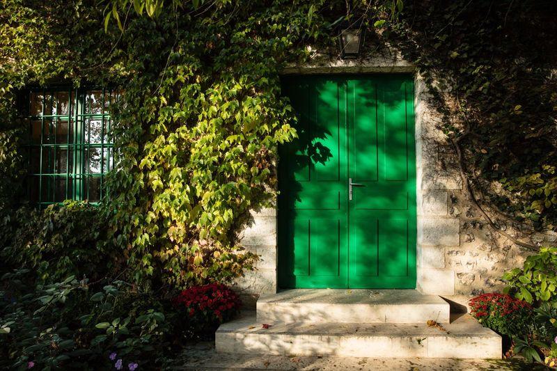 Open door in front of building