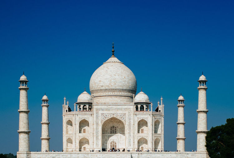 Classic photo of Tajmahal Arch Architecture Blue Building Exterior Clear Sky Cultures Gorgeous India Indian Outdoors Scenery Scenic Seven Wonders Seven Wonders Of The World Sky Stunning Tajmahal Tourist Attraction  Travel Destinations Traveller White