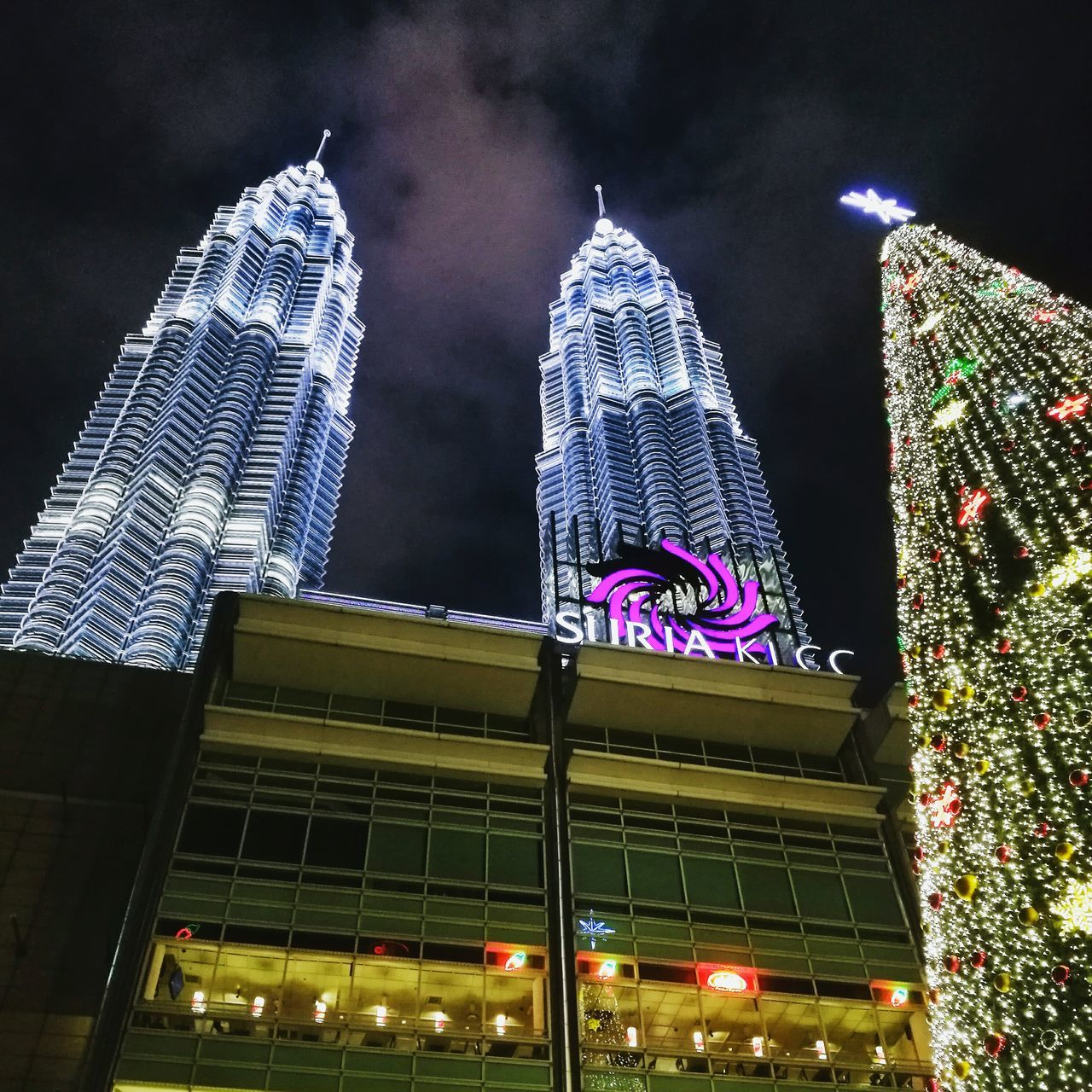 architecture, building exterior, night, built structure, illuminated, low angle view, city, skyscraper, tall - high, modern, travel destinations, outdoors, travel, no people, sky