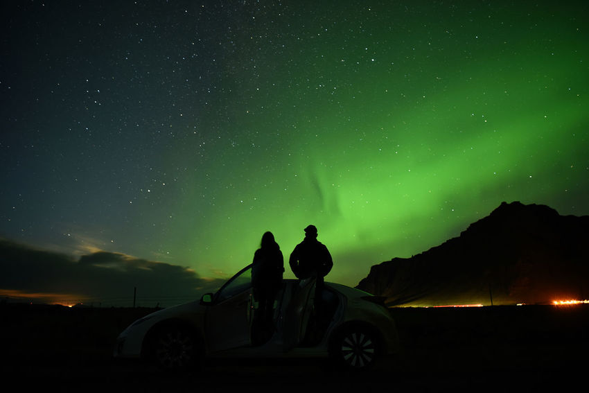 Aurora with silhouette love romantic couple standing on the car Capture Tomorrow Night Star - Space Sky Beauty In Nature Two People Scenics - Nature Men Real People Car Land Vehicle Mode Of Transportation Nature Space Transportation Togetherness Leisure Activity Silhouette Astronomy Lifestyles Motor Vehicle Couple - Relationship Outdoors Aurora