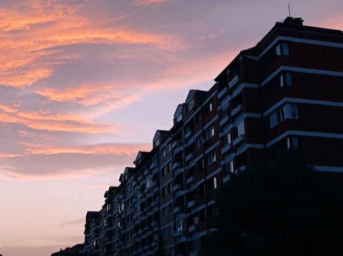 Low angle view of building against sky at sunset