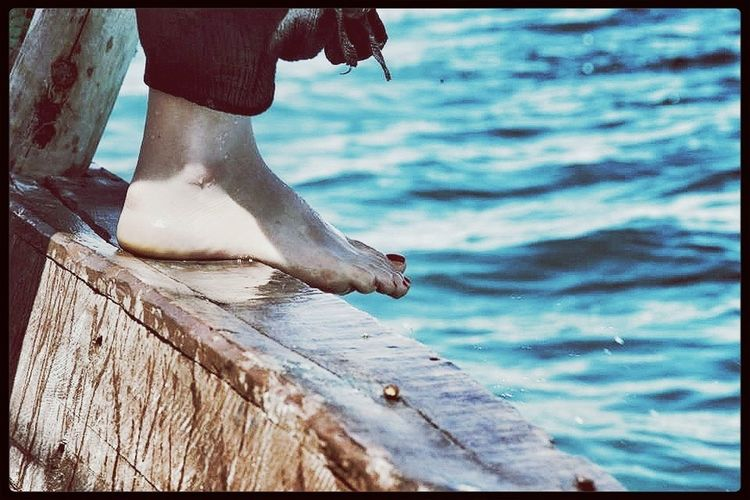 Foot On the rail of a Sailing Boats In the Ocean
