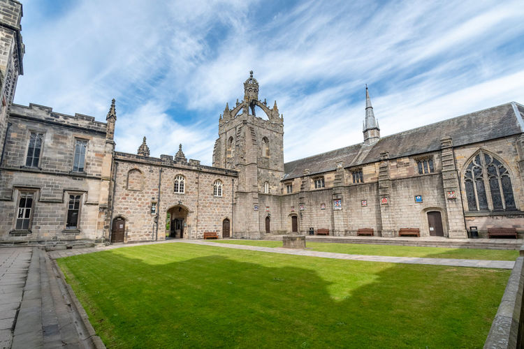 Aberdeen University King's College building captured on a beautiful late summer morning. Founded in 1495 this is one of Scotland's oldest centres of learning Aberdeen University Scotland Architecture Building Exterior Built Structure Sky Grass Cloud - Sky Building The Past History Nature Belief Spirituality Religion Place Of Worship Day Travel Destinations Plant Lawn Outdoors