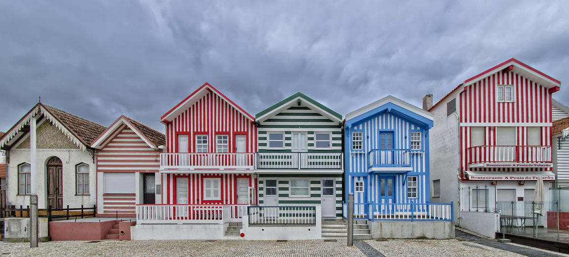 Houses on beach against sky
