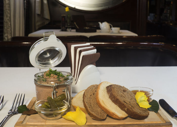 Fresh pate with bread on wooden board Board Bread Breakfast Brown Bread Close-up Day Food Food And Drink Fresh Freshness Healthy Eating Indoors  Jar No People Pate Plate Ready-to-eat Sandwich SLICE Table Toasted Bread Wooden