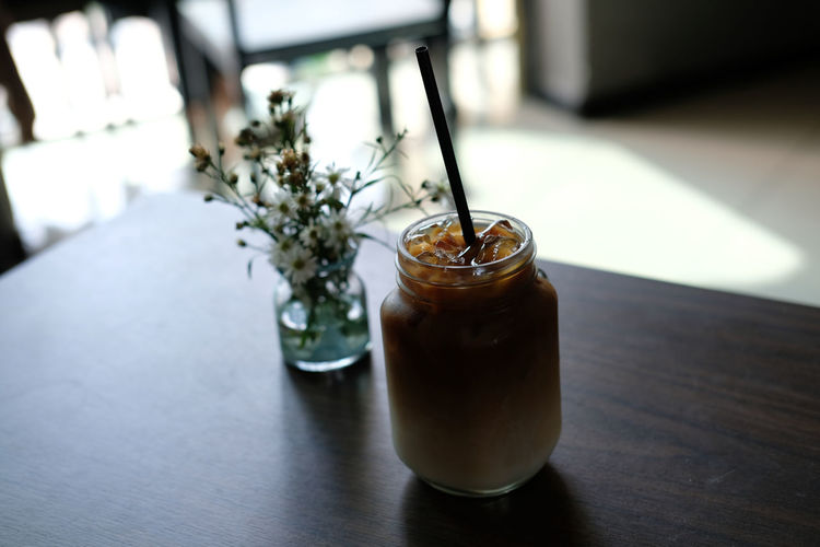 Drinking A Latte Close-up Day Drink Drinking Glass Drinking Straw Focus On Foreground Freshness Indoors  Nature No People Table
