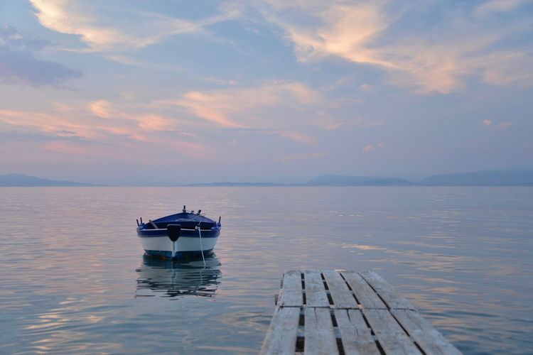 CORFU ISLAND Greece Horizon Over Water Little Boat Nature No People Outdoors Quiet Place  Sea Sky Sunset Tranquil Scene Tranquility Water Waterfront