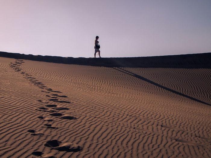 Man walking in the maspalomas sand dunes