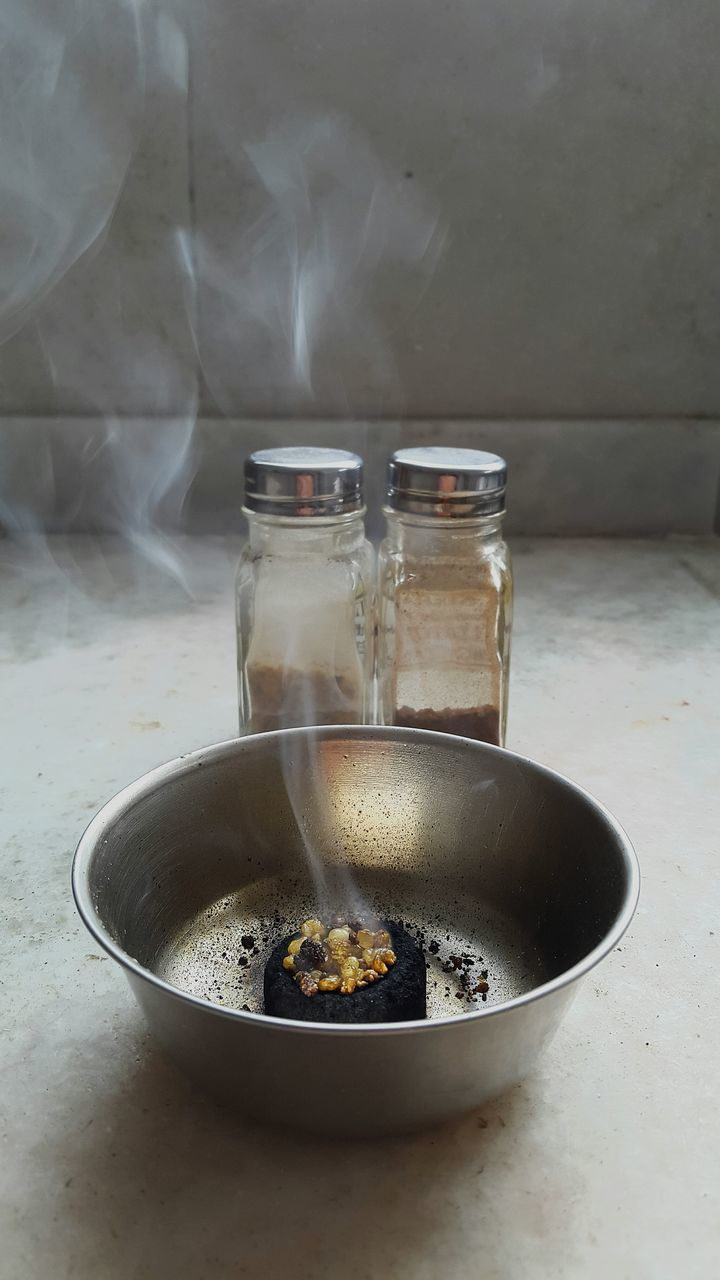 High Angle View Of Smoke From Incense In Container