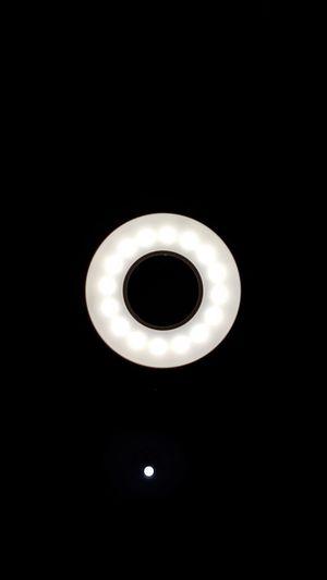 Directly below shot of illuminated lamp against black background