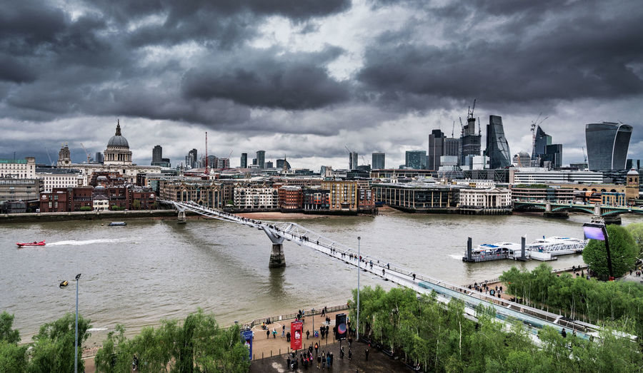 Stormy sky over city, with Millennium bridge in foreground. London, United Kingdom. Millennium Bridge River Thames River Thames Skyline London Skyline Storm Clouds Stormy Sky St Paul's Cathedral The City London LONDON❤ Bridges Built Structure Building Exterior Architecture City Cloud - Sky Sky Water Transportation River Building Travel Destinations Cityscape Travel Overcast Nature Nautical Vessel Bridge Connection Bridge - Man Made Structure No People Outdoors Passenger Craft