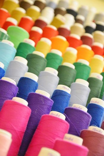 Full frame shot of colorful spools of thread