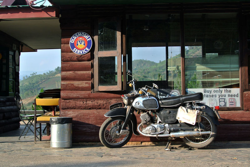 Bike Biker Transportation Mode Of Transportation Land Vehicle Motorcycle Day Window Architecture Built Structure No People Glass - Material Transparent Building Exterior Outdoors Sign Stationary Road Travel Text Building Communication KhaoKho,Thailand