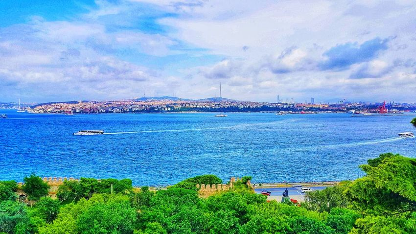 Viem of Istanbul across Bosphorus River from Topkapi Palace, Turkey Topkapi Palace Turkey💕 Bestview Photographer Befreebezen I Love2travel Travelblogger Travelwriter Followback Water Nautical Vessel Sea Beach Yacht Sailboat Sky Horizon Over Water Cloud - Sky Harbor Boat EyeEmNewHere
