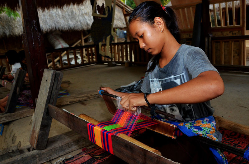Girl working with handloom