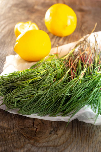 Agretti on wooden table with lemons Food And Drink Salad Agretti Citrus Fruit Close-up Food Food And Drink Foodphotography Freshness Fruit Green Color Healthy Eating Herb High Angle View Indoors  Lemon Lemons No People Rosemary Still Life Table Vegetable Vegetables Wellbeing Wood - Material Yellow