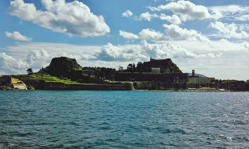 Corfu Old Fortress Travel Blue Cloud - Sky Water Tourism Architecture Arrival Travel Destinations Landscape Ancient Tree Day Outdoors No People Sky First Eyeem Photo