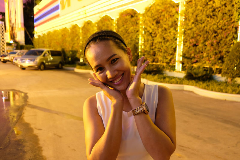 Portrait of a smiling young thai woman in city