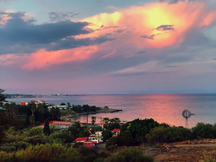 Romantic evening mood about Rhodes AMP PICTURES Sky Cloud - Sky Water Sea Beauty In Nature Sunset Scenics - Nature Nature Horizon Over Water Horizon Plant Beach Land Tree Tranquility Outdoors Tranquil Scene No People Idyllic