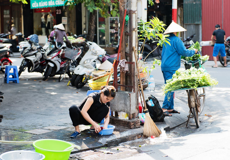 Vietnamese street vendors act and sell their vegetables and fruit products in Hanoi, Vietnam Act Baskets Bicycle Fruit Hanoi Hanoi, Vietnam Products Sell Street Vendors Vegetables Vietnamese Food Vietnamese Fruit Vietnamese Girls Vietnamese Street Vendors Vietnamese Woman ,