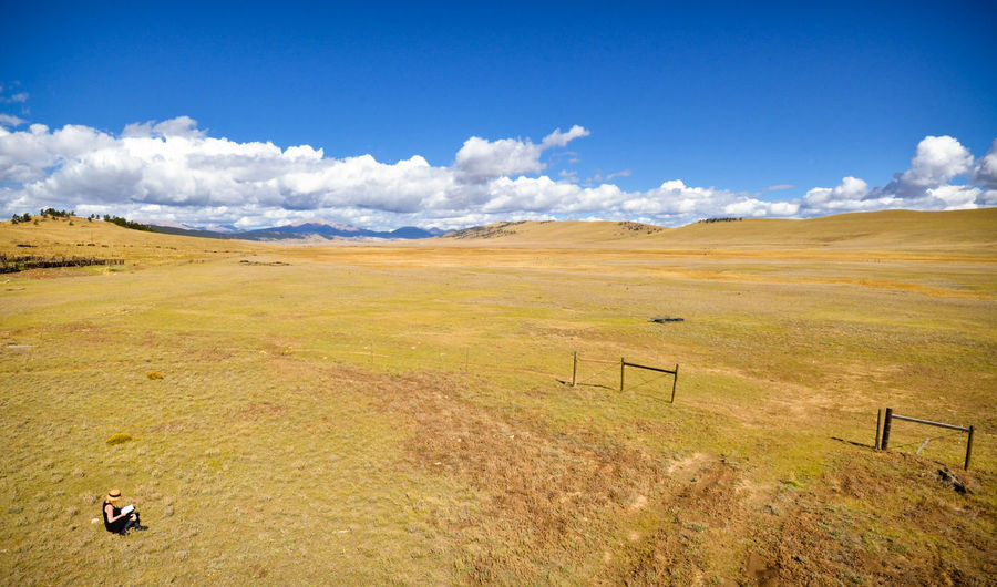 A Place to Read Colorado EyeEmNewHere Ranch Read Reading Woman Aerial View Beauty In Nature Book Cloud - Sky Girl Grass Landscape Mountain Outdoors Reading A Book Silence Solitude Tranquil Scene Tranquility Valley Wide Open Spaces