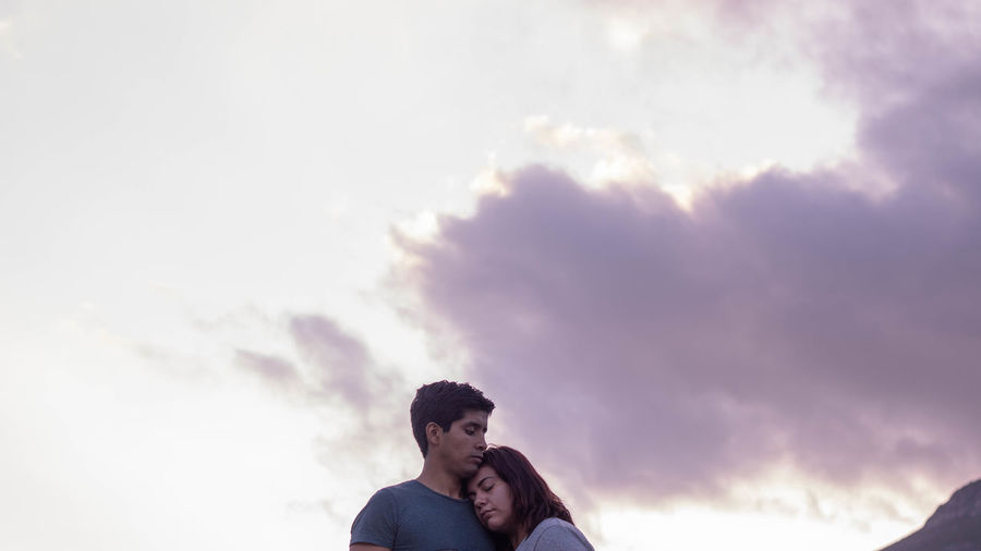 Low angle view of couple against sky