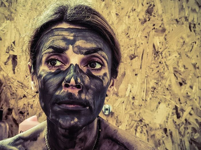 Close-up of woman with black make-up