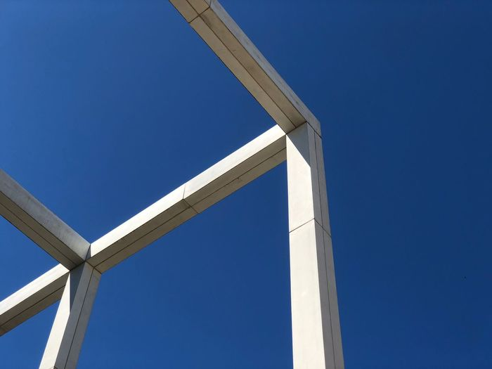 Concrete Blue Clear Sky Architecture Sky No People Day Built Structure Low Angle View Outdoors Connection Construction Frame Construction Industry Sunny Industry Architectural Column White Color